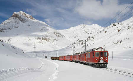 A train going through a snowy area