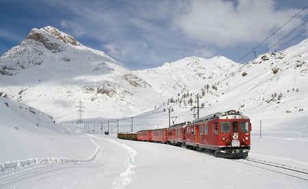 A train going through a snowy area
