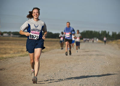 She is running a marathon. (Transitive)