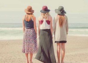 Three girls looking at the ocean
