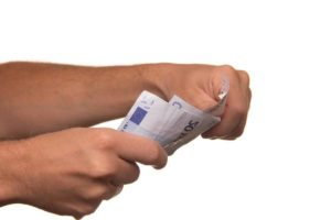 two hands lending money